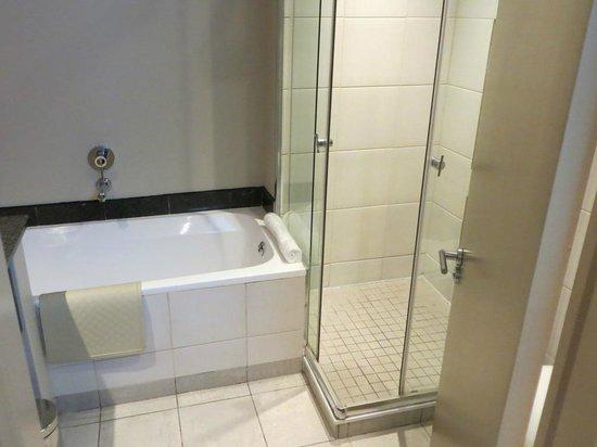 Peermont Mondior at Emperors Palace: Bathroom with bath & shower