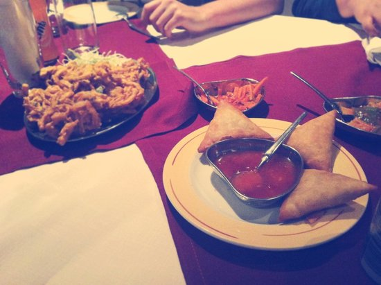 Golden Leaf: Chicken Samosa with sweet sour and onion rings
