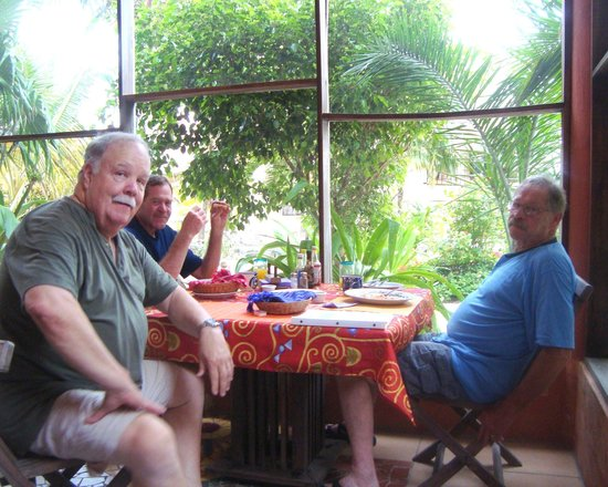 Mayan Beach Garden: The boys linger over good coffee after wonderful made-to-order breakfasts.
