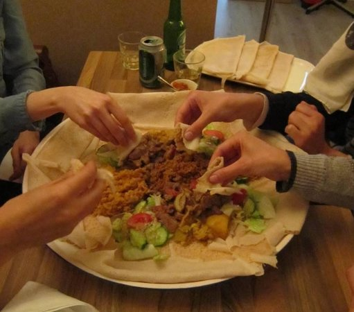 Axum: Eating injera with hands