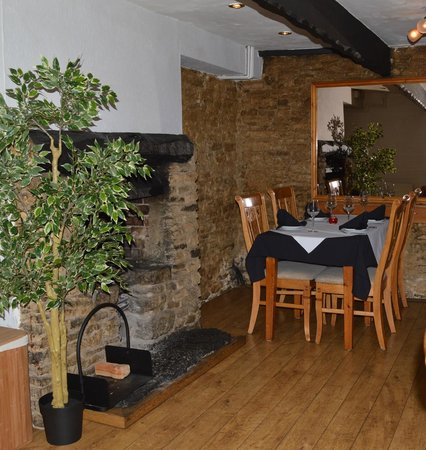 The Muntjac: Lower restaurant fireplace