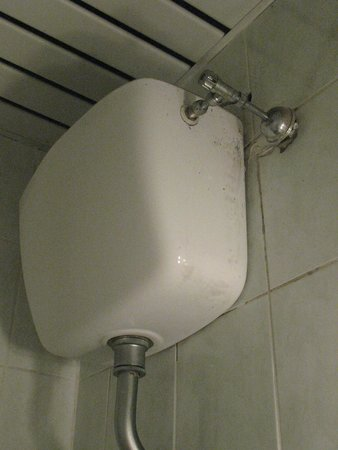 Embassy Hotel : Wall Toilet Tank with Dirt