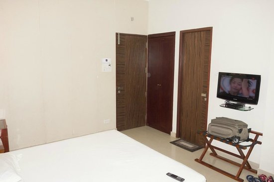 Bed room to main door view @ room no 206 Akshay INN