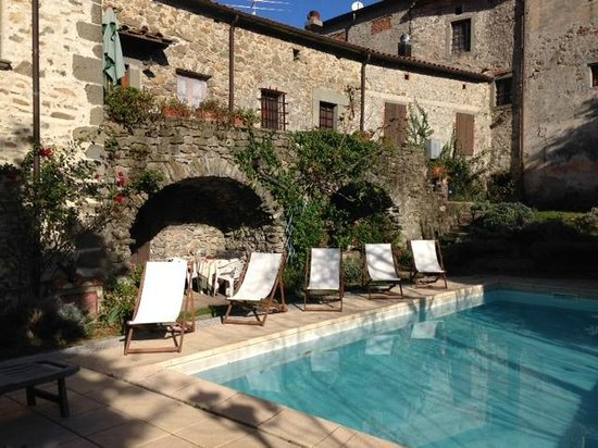 Palazzo del Duca : View of our room, pool of hotel, sun tanning chairs