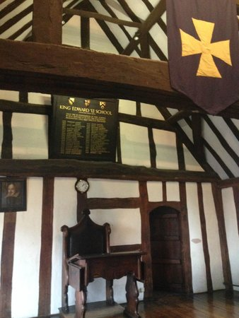 Shakespeare's Schoolroom & Guildhall: Headmasters Chair & past Headmaster above.