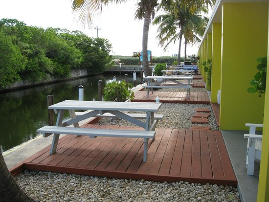 Coconut Cay Resort & Marina: Outdoor decks & tables of waterfront rooms on canal.