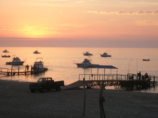 Hotel Playa Del Sol: The fishing fleet and loading dock at sun rise