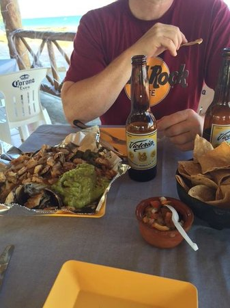 Tio Jose: Chicken nachos served with fresh guac and grilled pineapple