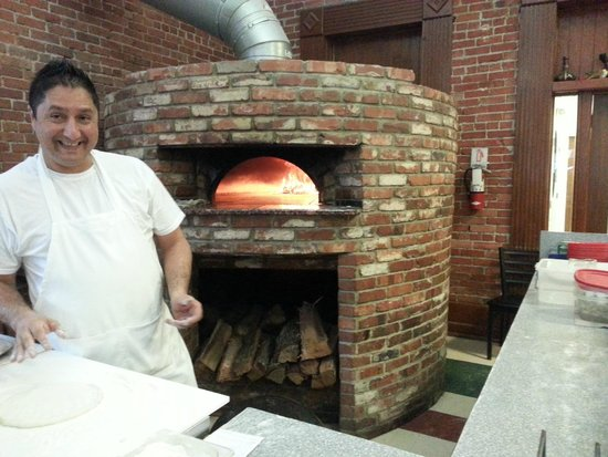 Giovanni's main street kitchen: round brick oven with great view of flames