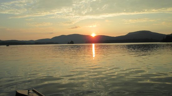Blue Mountain Lake Boat Livery: Looking due west as the sun drops below the ridges near Castle Rock