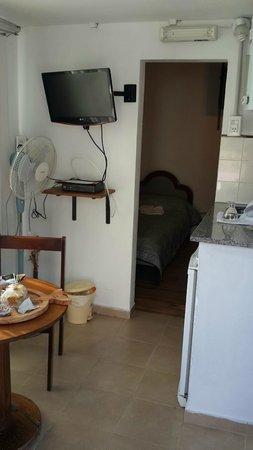 Posada Caracoles: comedor y habitación