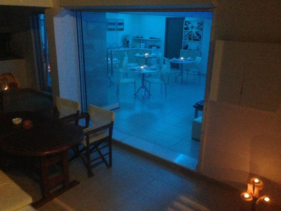 Saint Vlassis Hotel: Breakfast area alight at night.
