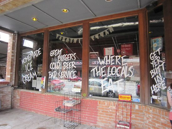 Twisted Root Burger Co. : Signs on the outside windows