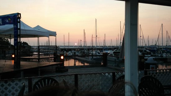 Lombardi's Italian Restaurant : Sunset in August, 2014 We enjoy eating outside in the summer; indoors is lovely in the winter.