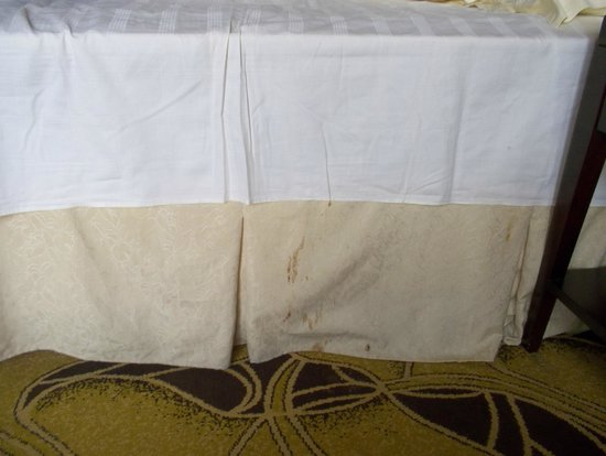Royal Century Hotel: Stained bed skirt