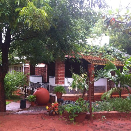 Inn Pondiville Forest Retreat: The buildings blending beautifully into the natural setting