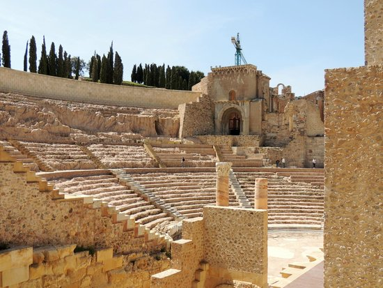 The modern amphitheatre near the ancient amphitheatre ...