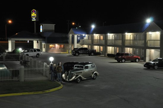 BEST WESTERN Inn of McAlester: View of the west wing and parking lot from the rear wing. The highway is just beyond the big sig