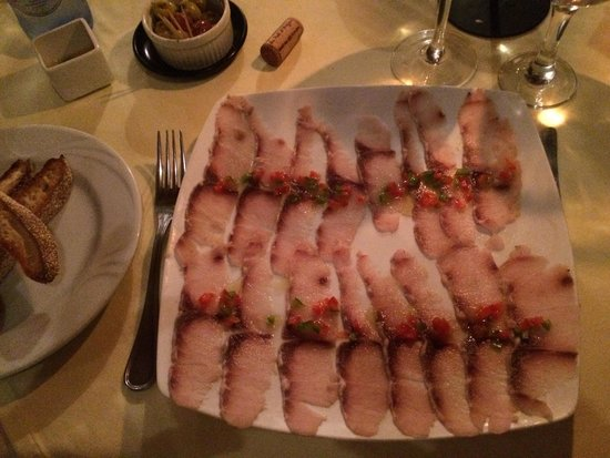Il mare: Lovely local fish carpaccio with grilled bread.