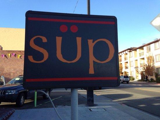 Sup: Sign outside restaurant.