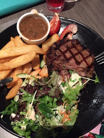 Buderim, Australia: 250 rump steak with salad, chips and pepper sauce gravy.