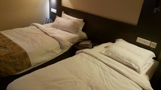 Goldfinch Hotel Mumbai: Small but comfortable bed with charging points above pillow