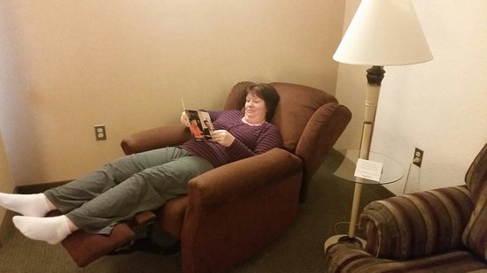Drury Inn & Suites Lafayette: My wife trying out the suite recliner