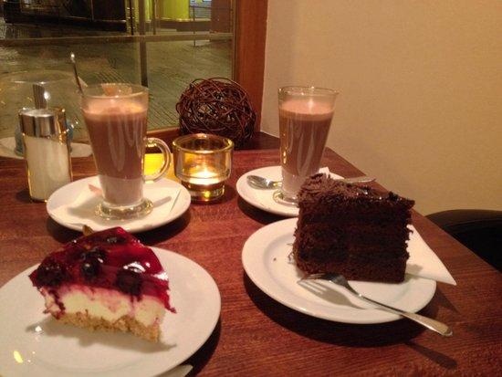 Cake Cafe Prague: 2 Hot chocolate with cheescake and madagascar cake! Delicious