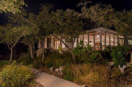 Alexandra's House: Screened porch at night