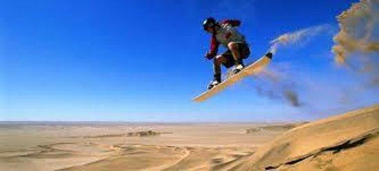 Explore Sahara Tours: sandboarding