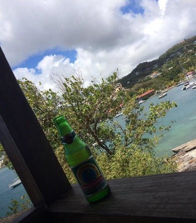 "White Sands Cottages: A Vincy's version of ""hooray beer"" on the veranda"