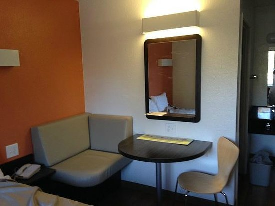 Motel 6 Monterey - Marina: next to the bed lil table, mirror ifo bathroom