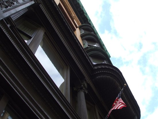 Hotel Providence: Rich wood mouldings on from of building.