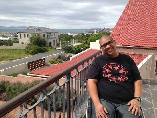 On The Vermont Guest House: My hubby who wheelchair bound enjoying the balcony at the guest house