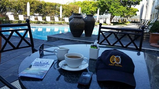 Protea Hotel by Marriott Knysna Quays: Early morning coffee by the pool.