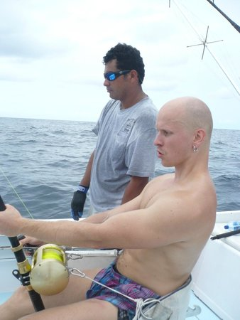 Coiba Adventure Sport Fishing: Heavy pullingwith the legs to reel in the 500 lbs black marlin