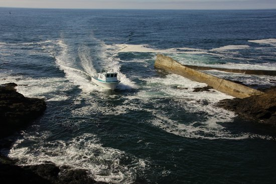 Channel House: View from balcony of boat entering Depoe Bay harbour