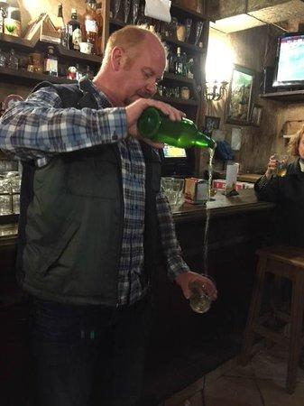 Adventurous Appetites Tapas Tour: James pours some cider at a quaint pub