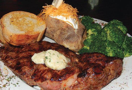 Adventures Pub & Spirits: 14 oz Ribeye Steak Dinner
