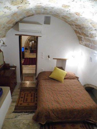 Bastione Malvasia Hotel: Vue De La Chambre Et Enfilade Des Pièces