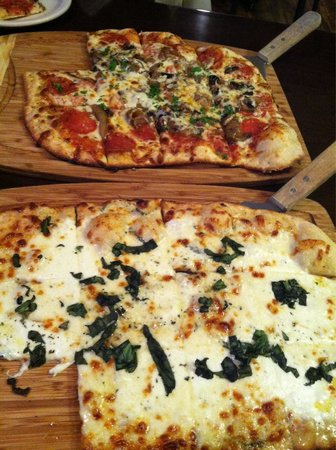 The Brick Oven Bistro: Foreground - white pizza as listed on menu  Background- create your own- pepperoni, mushroom, an