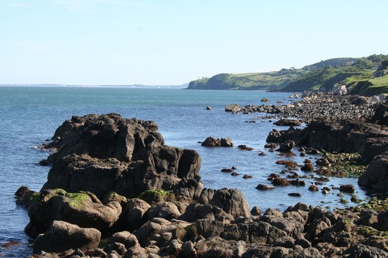 The Gobbins: View of Black Head lighthouse.