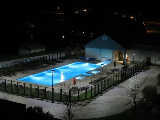 night view of the pool they have a fire pit too. Black Bedroom Furniture Sets. Home Design Ideas