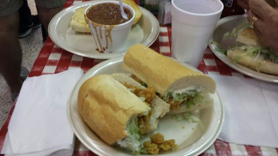 Crawfish poboy (dressed) and red beans and rice.