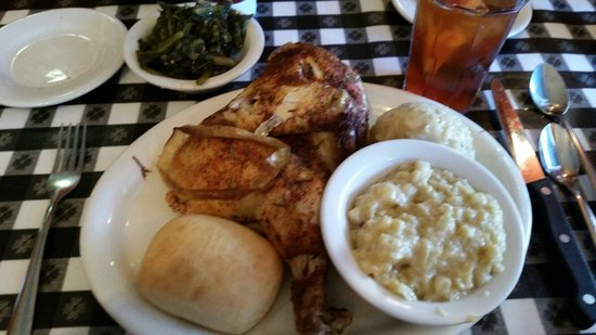 Cupboard Cafe: Baked chicken with dressing, creamed corn and turnip greens.