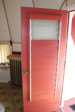 Old fashioned louvered door with most of the glass panes replaces ...