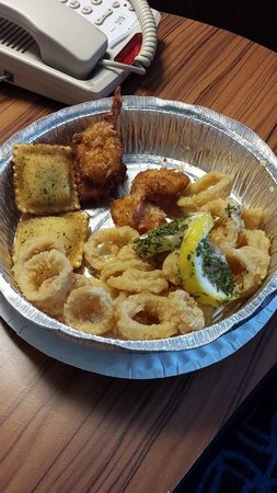 Napoli's Italian Restaurant: Appetizer Combo: toasted ravioli, calamari, fried shrimp, and stuffed mushrooms (other photo)