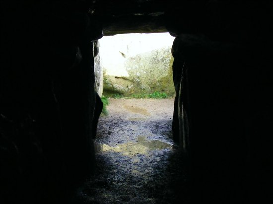West Kennet Long Barrow: The entrance from inside the barrow (muddy!)