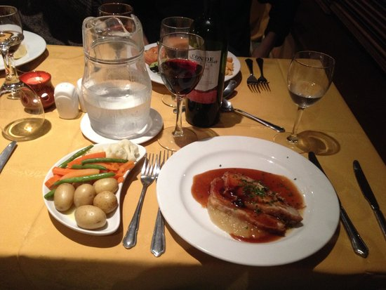 The Downhill Inn: Dinner - Pork with apple sauce and veggies, served with red wine.