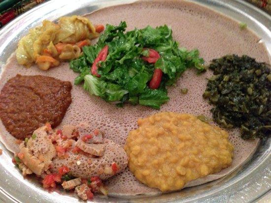 Zeni Ethiopian Restaurant : Veggie sampler; two more dishes were added.  Delicious!